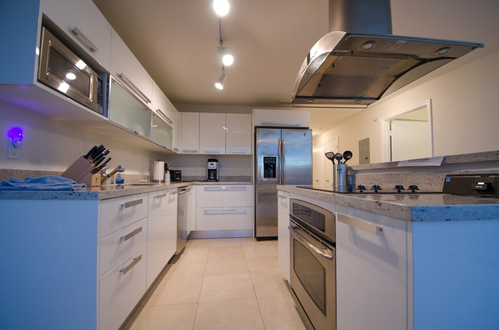 kitchen with stainless steel appliances and white cabinetry