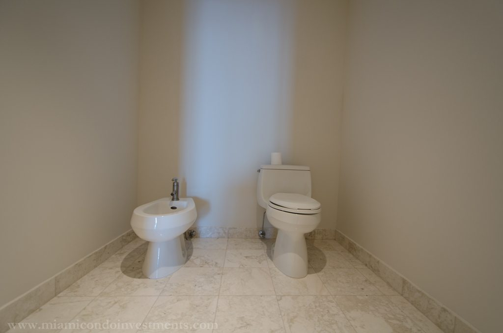 hers bathroom with bidet and toilet