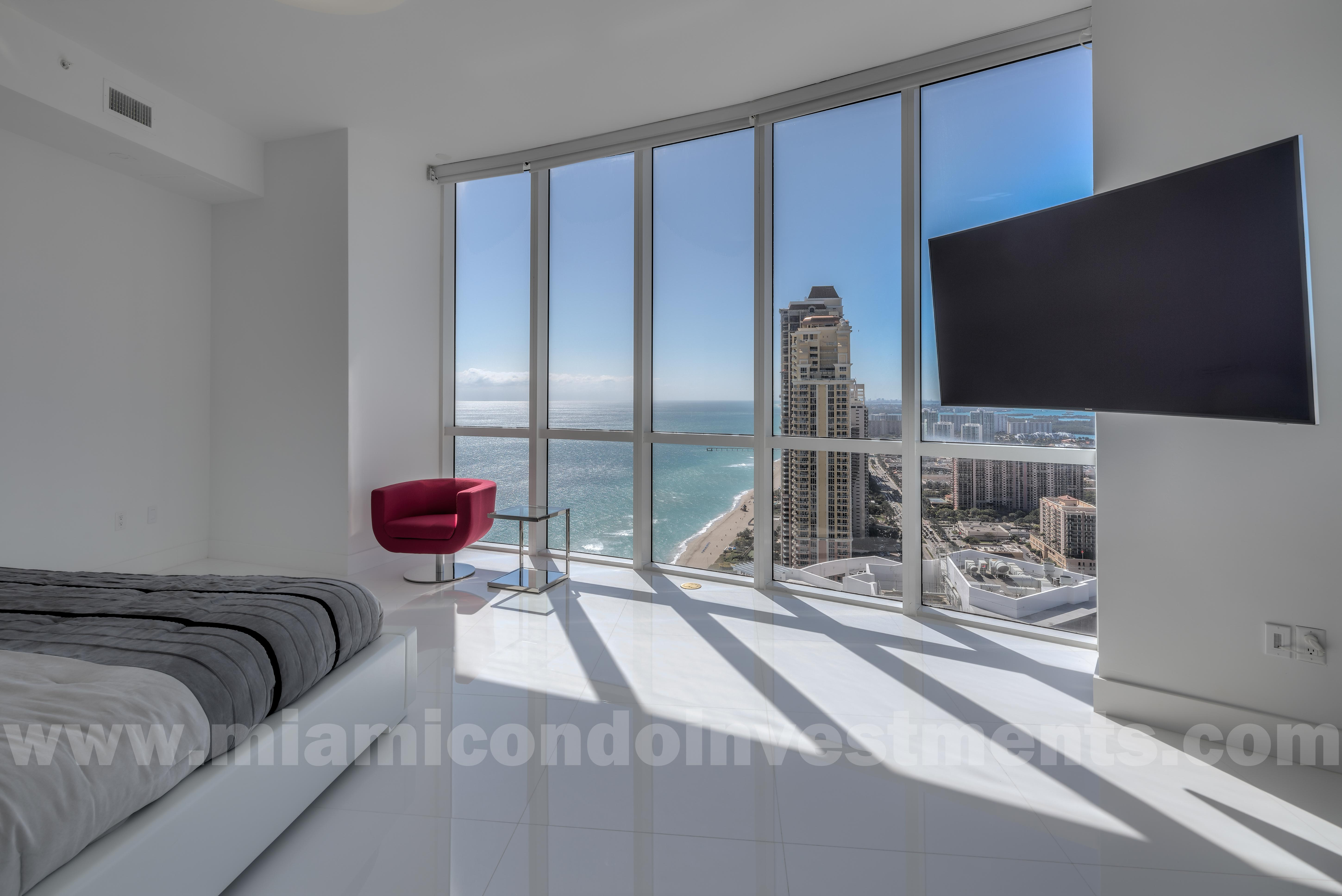 view of ocean and coastline from master bedroom