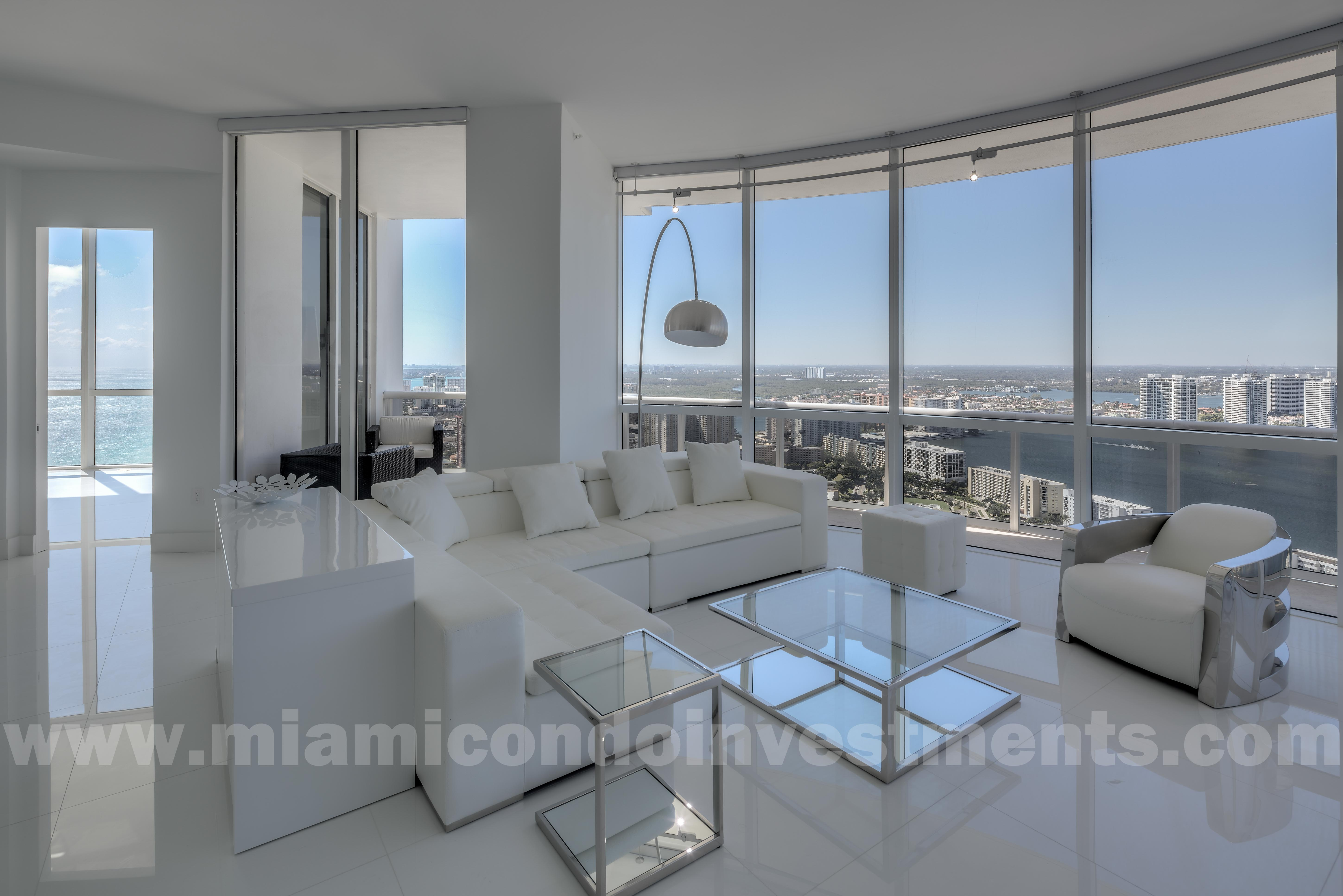 view of ocean, city, and intracoastal waterway from living room