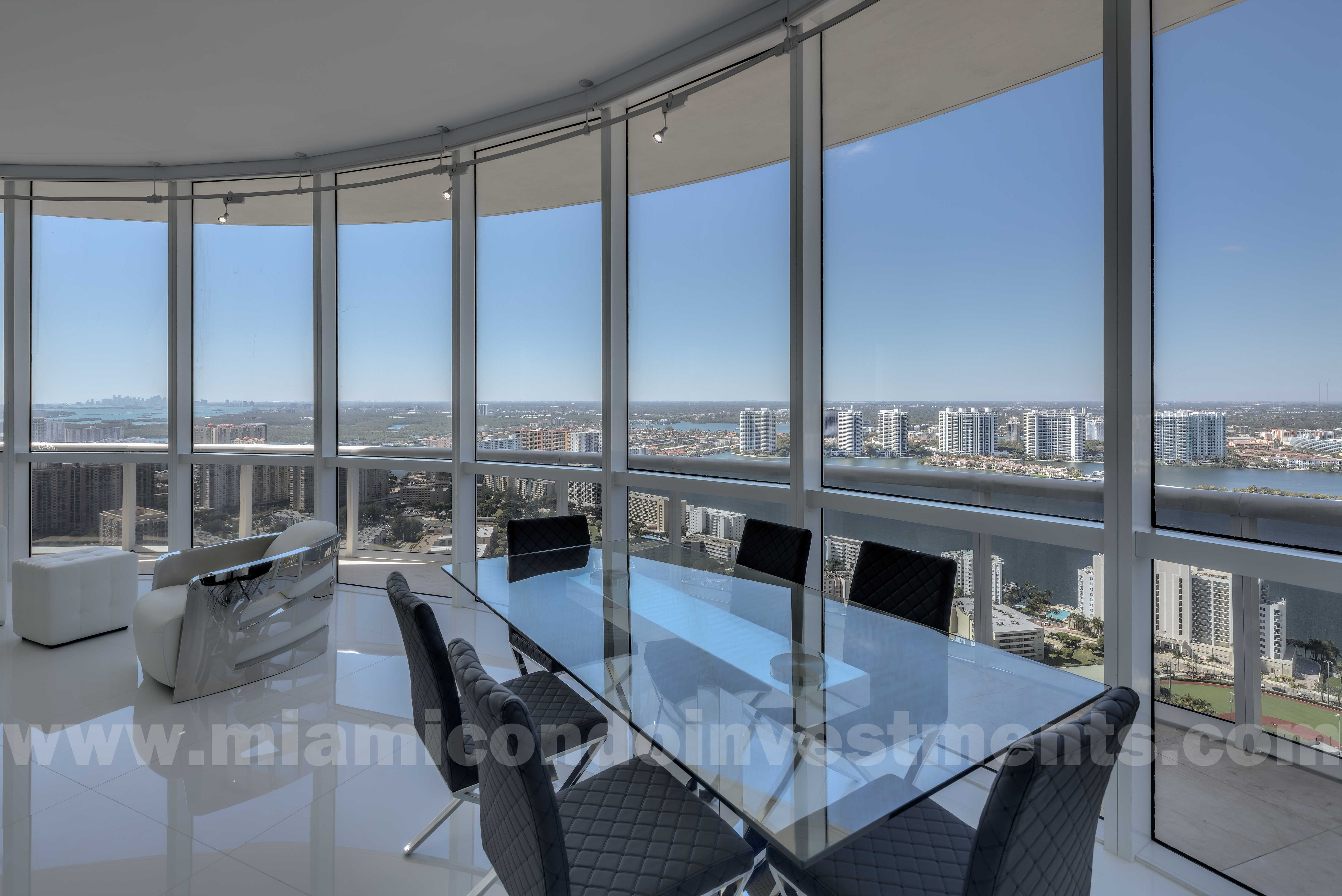 view of intracoastal waterway and Miami skyline from dining table