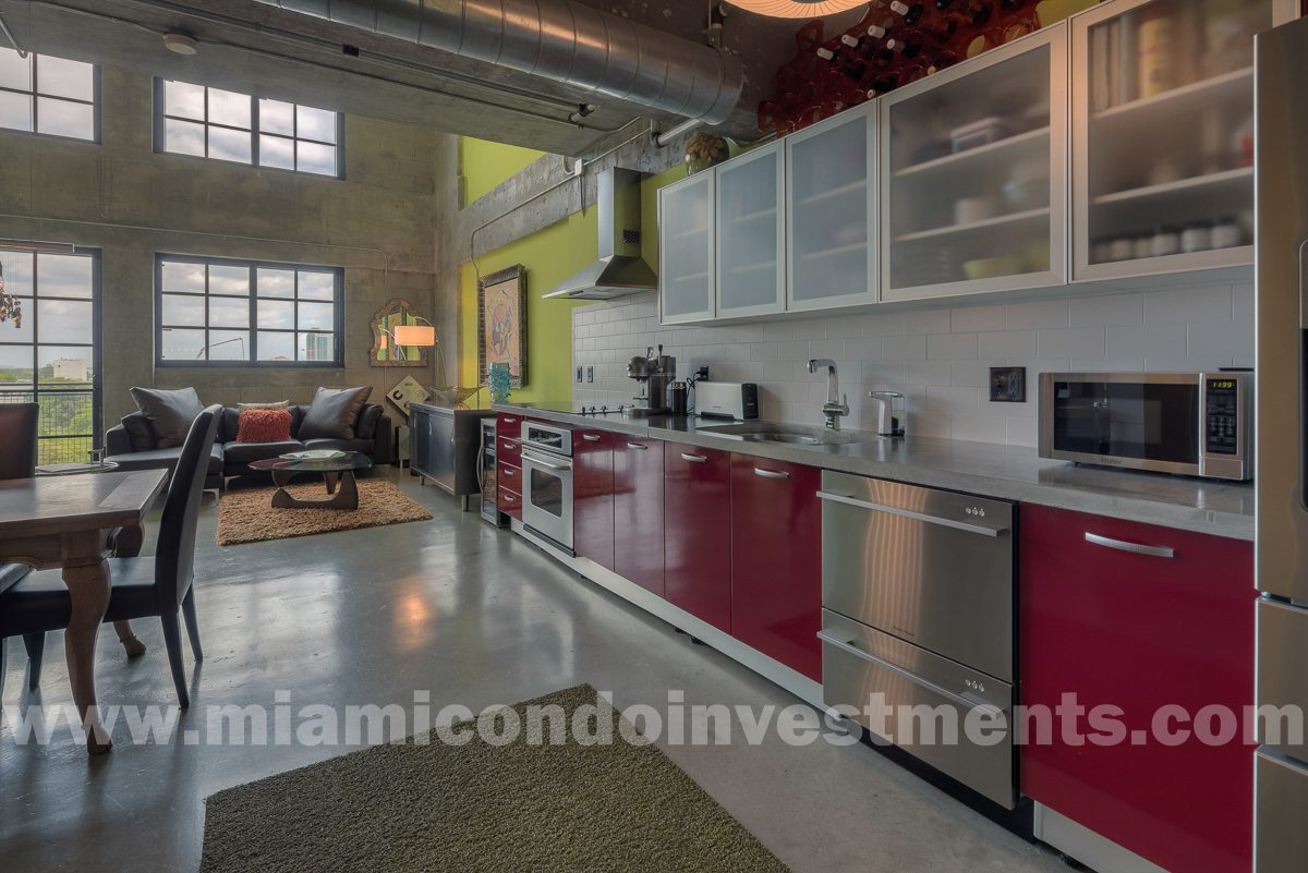20-foot ceilings. True industrial loft with exposed ceilings and ductwork.