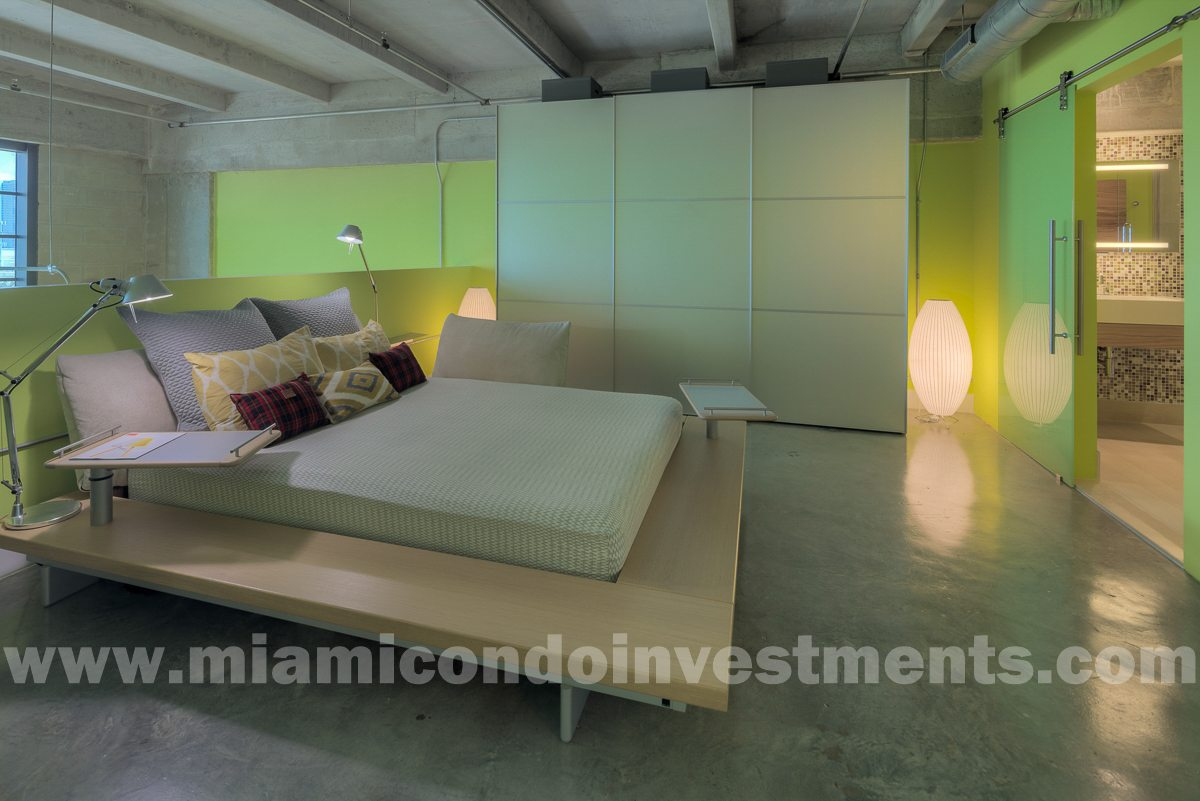 Peter Maly platform bed by Ligne Roset with custom latex foam mattress. Salvarani closet with platinum frosted glass doors.