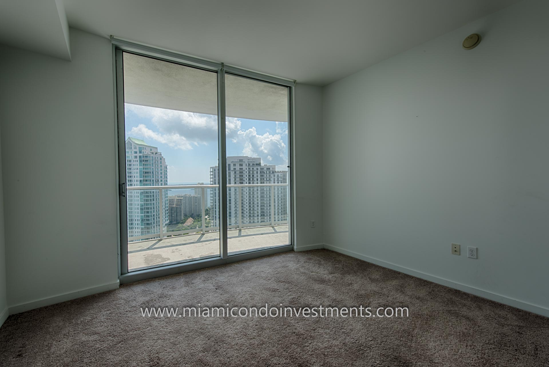 second bedroom with views of the Miami River, Brickell Key, Brickell, and Biscayne Bay