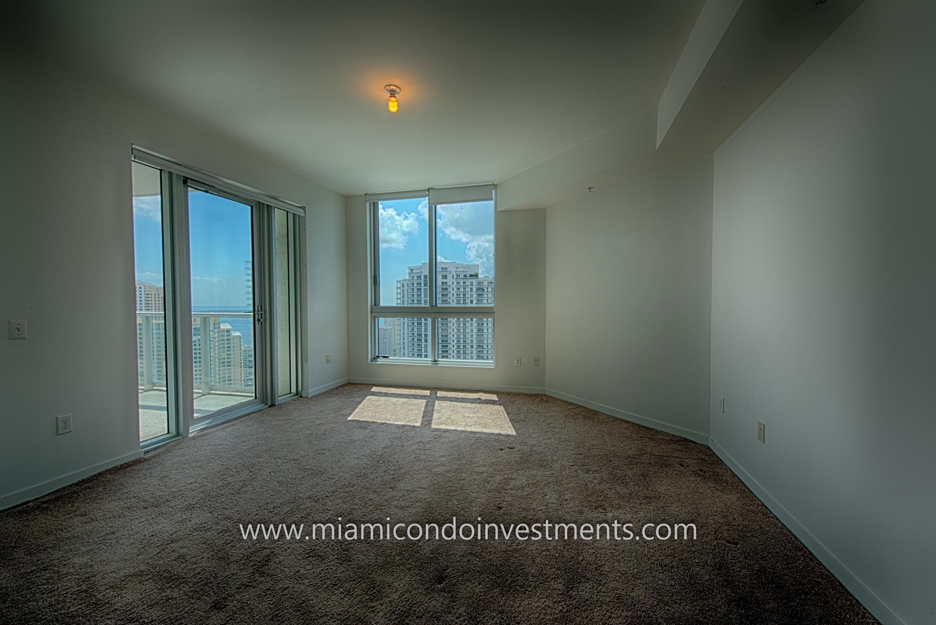 master bedroom with views of the Miami River, Brickell Key, Brickell, and Biscayne Bay
