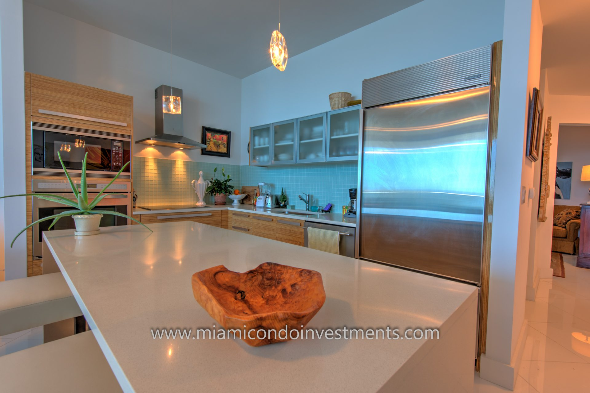 Italian wood cabinetry and stone countertops.