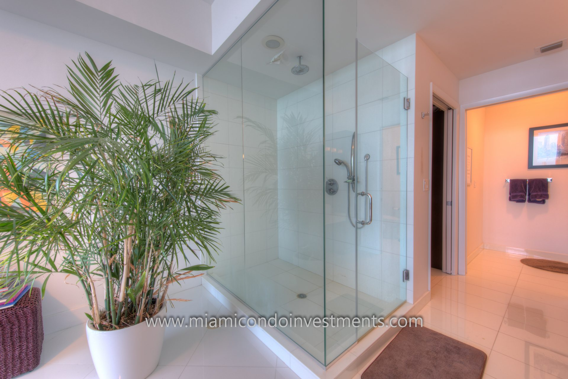 glass enclosed shower with direct bay views