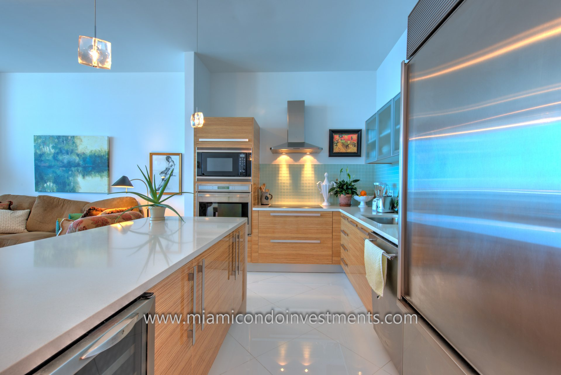 Stainless steel appliances by Wolf & Sub-Zero. Includes refrigerator, wine cooler, dishwasher, oven, stove, and microwave.