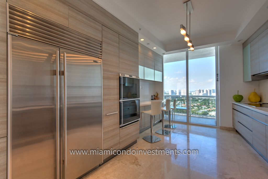 renovated kitchen with custom Italian cabinets and high-end appliances by Sub-Zero, Gaggenau, and Miele