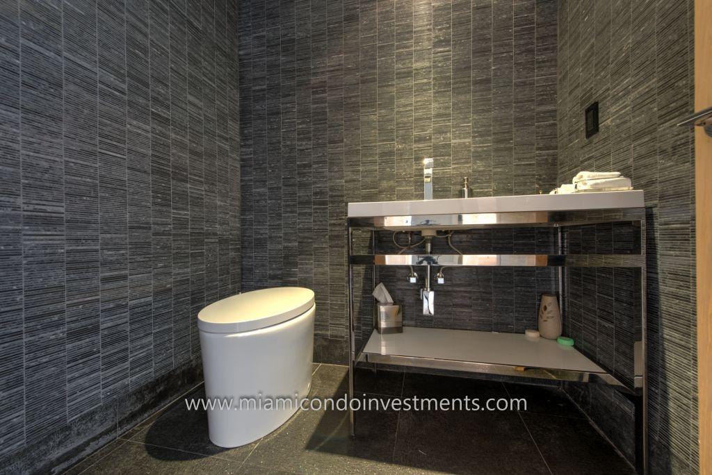renovated half bath at Trump Palace in Sunny Isles Beach