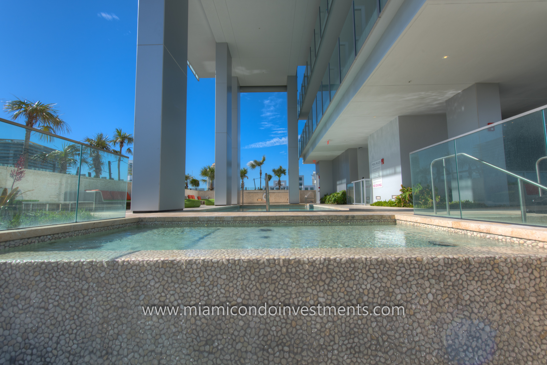 GLASS Miami Beach pool deck with landscape design by Raymond Jungles