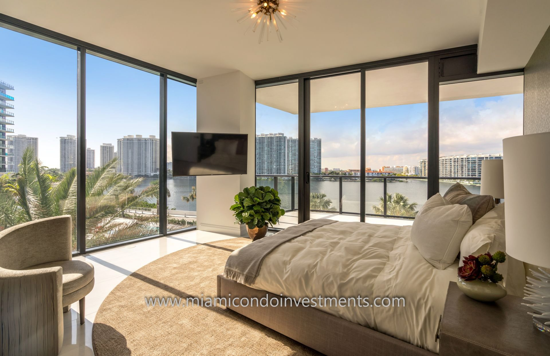 furnished bedroom with water view