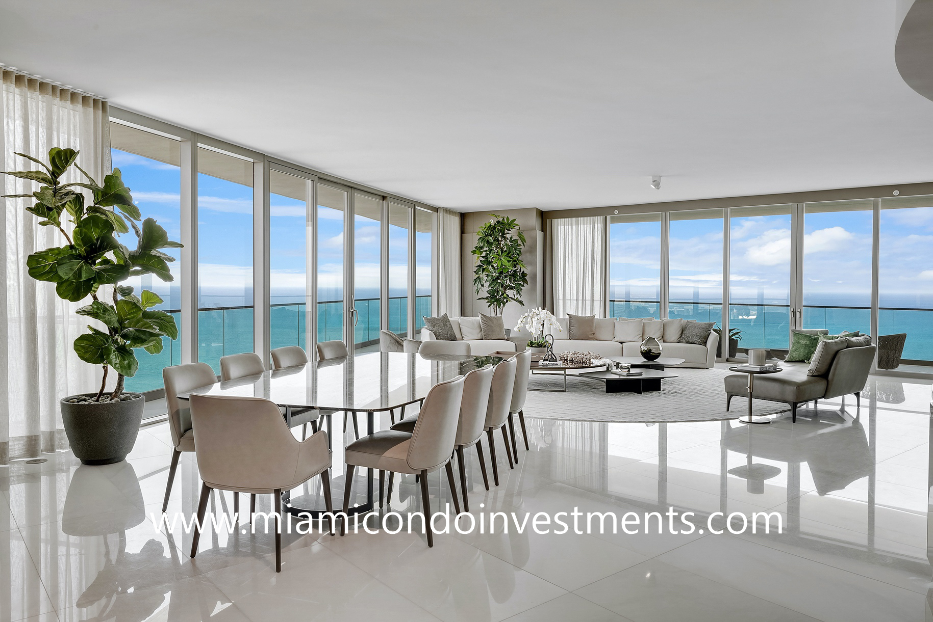 dining and living room areas with direct ocean views