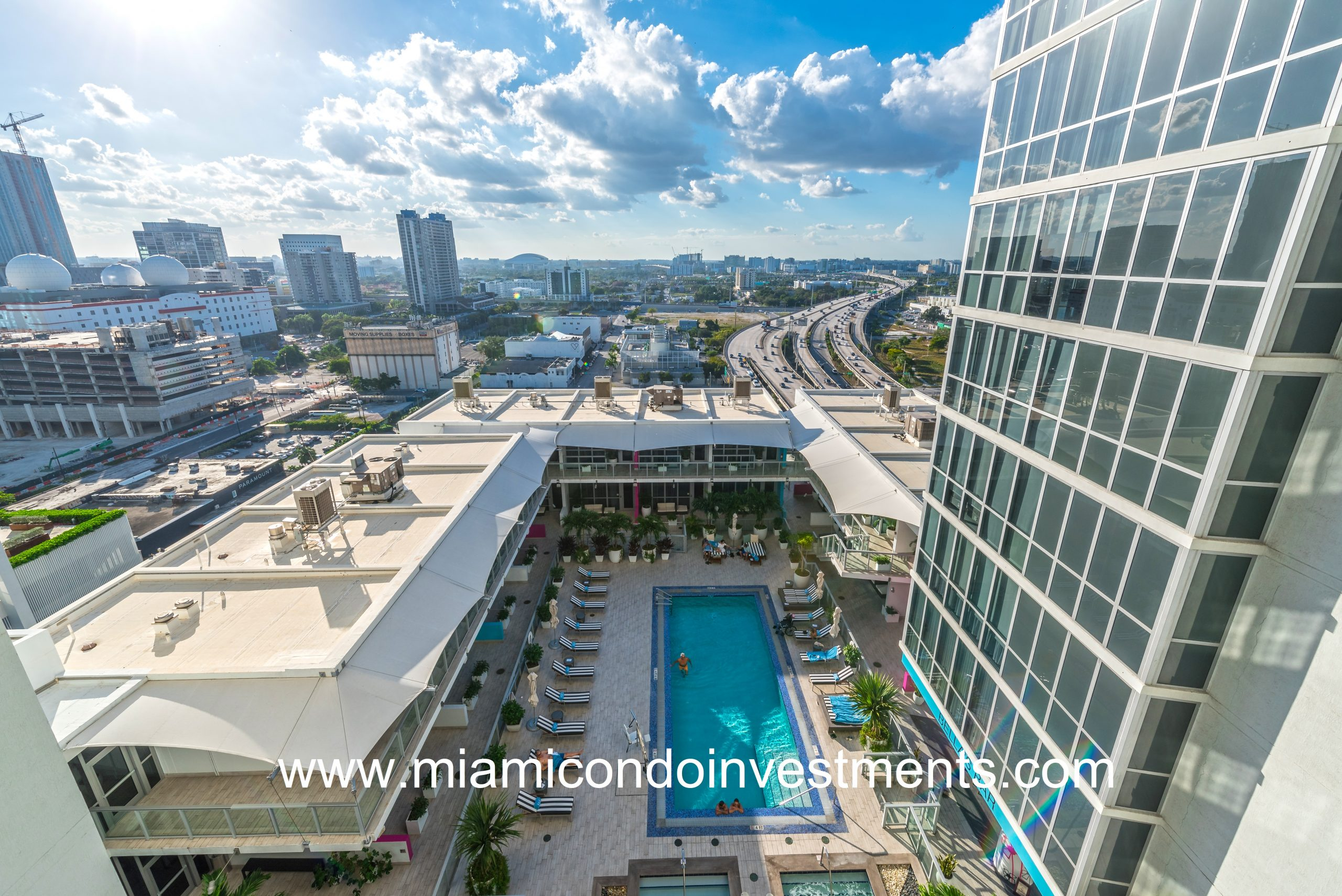 The Marquis Residences of Miami features a lagoon style sunset pool with poolside juice and salad bar.