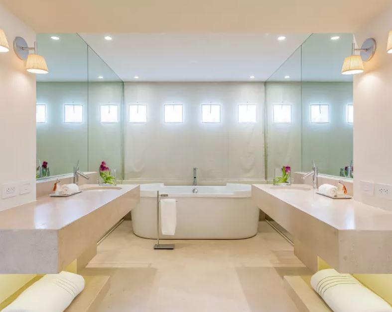 Custom bathroom with double vanities, and jacuzzi tub.