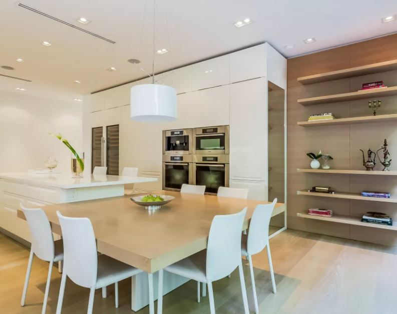 Shakira's Modern kitchen with large entertaining space, double oven and expansive wine refrigerator.