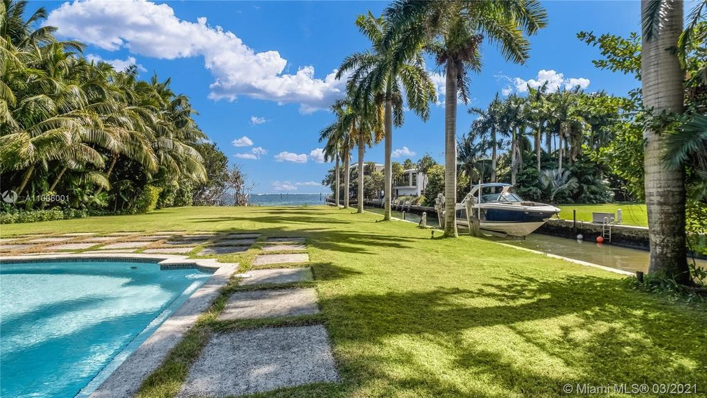 Dock and Yard Views of Coconut Grove Mansions